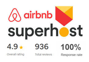 Badge: Airbnb Superhost, 100% response rate, 4.9 stars overall, 936 verified guest reviews